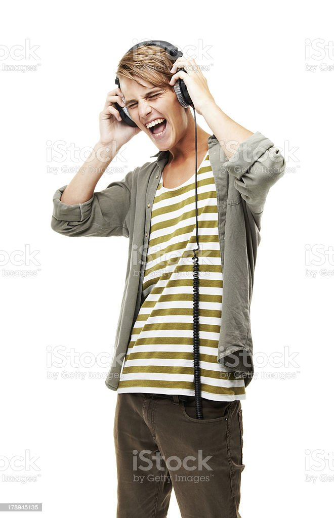 Rocking to the sounds on his headphones stock photo