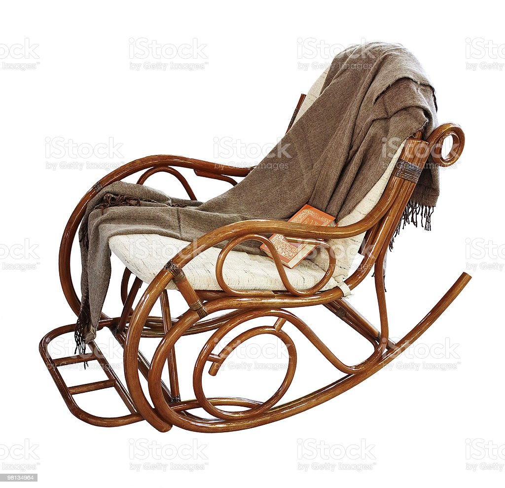 rocking-chair with rug and book royalty-free stock photo