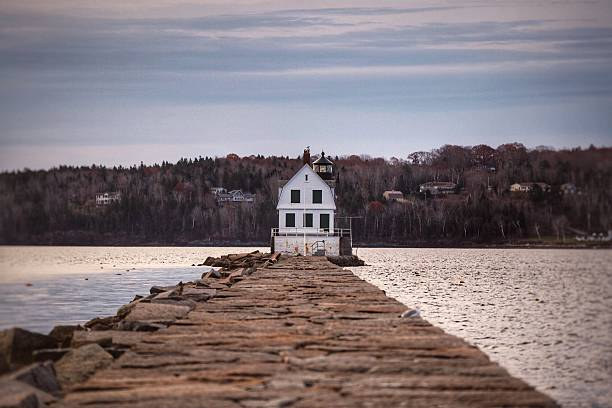 Rockland Breakwater Light Rockland Breakwater Light on a Fall Morning. groyne stock pictures, royalty-free photos & images