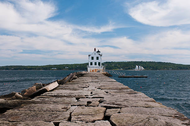 Rockland Breakwater Lighthouse A view of the Rockland Breakwater Lighthouse seen from the breakwater on Jameson Point in Rockland, Maine. groyne stock pictures, royalty-free photos & images