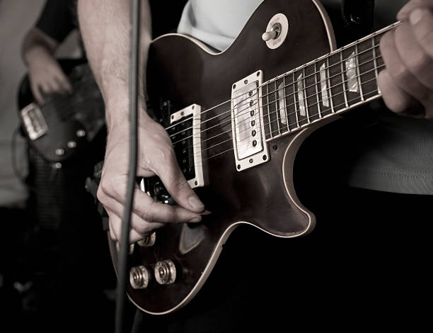 rock/pop guitar player - punk music stock photos and pictures