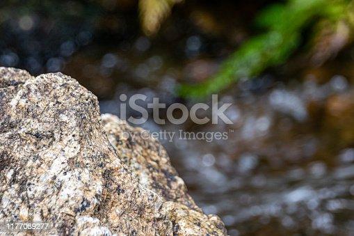 Rocks against a clear flowing stream