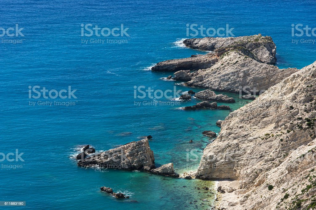 Rocks and blue waters near Petani Beach, Kefalonia, Greece stock photo