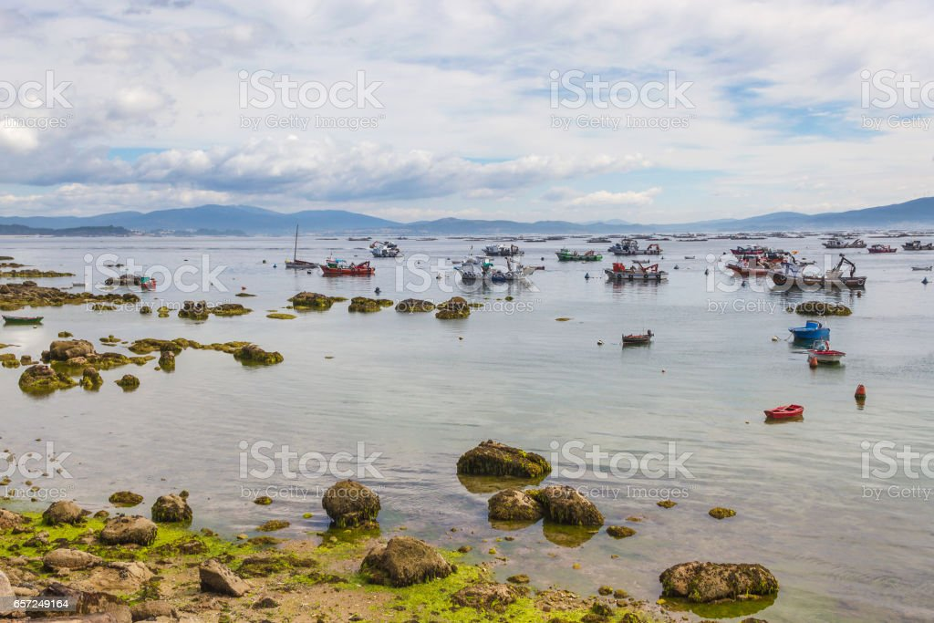 Rocks and boats royalty-free stock photo