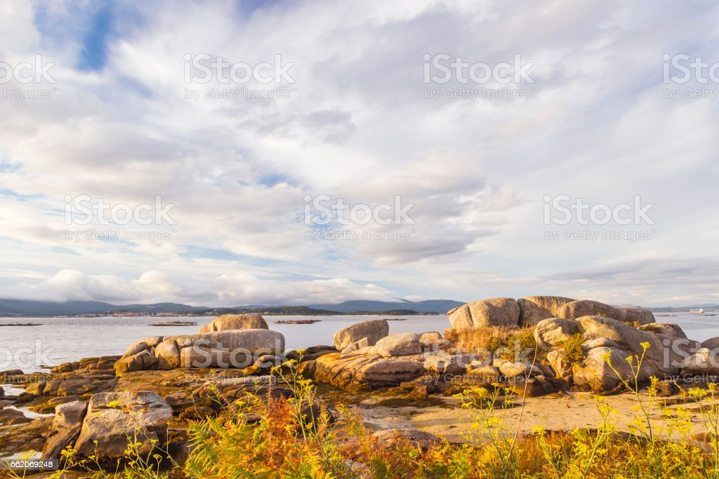 Rocks and clouds on the coast royalty-free stock photo