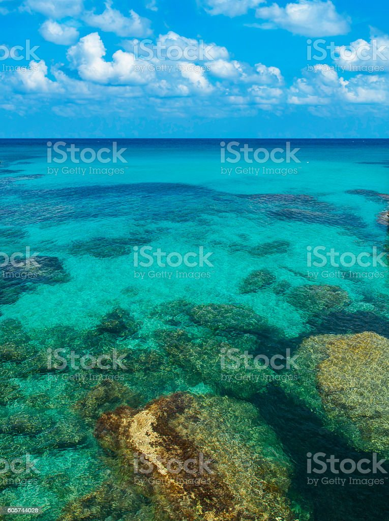 rocks and corals under turquoise sea water stock photo