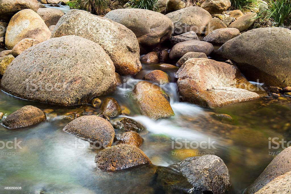 Rocks and flowing water. stock photo