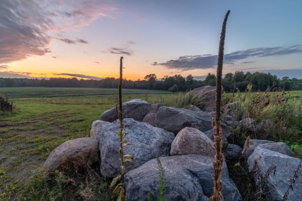 Rocks and Plantlife During Dramatic Sunset, Ohio USA stock photo