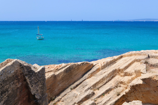 Rocks And Sailboat Stock Photo - Download Image Now - iStock