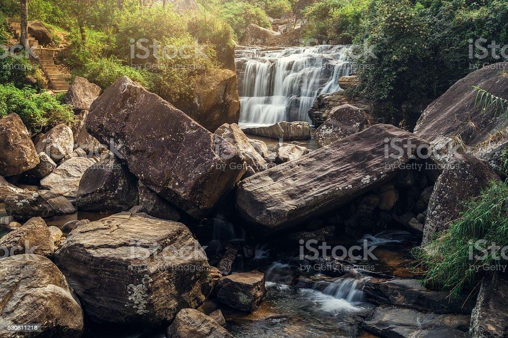 Rocks and small Ramboda waterfall in Sri Lanka stock photo