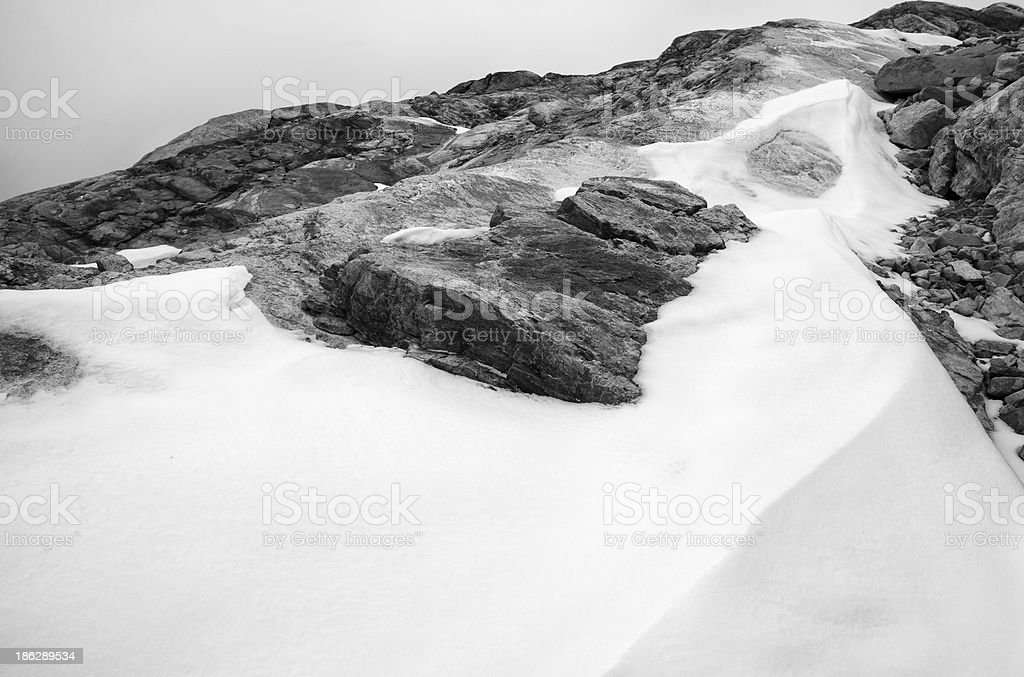 Rocks and snow in the high mountains of Jotunheimen, Norway stock photo