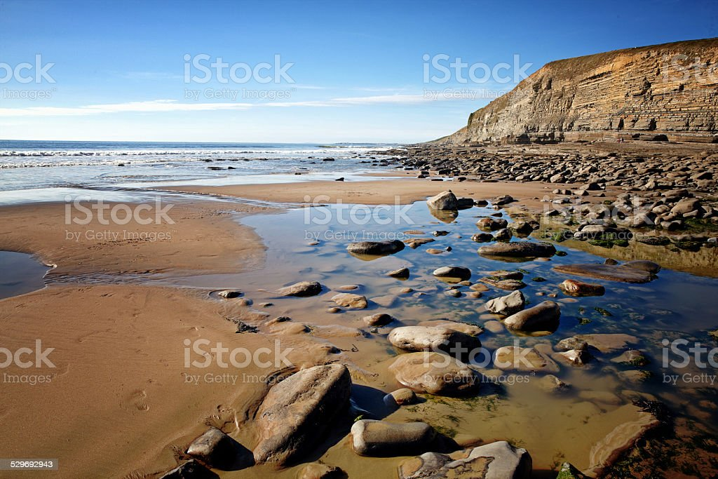 Rocks and strata formations at Welsh beach stock photo