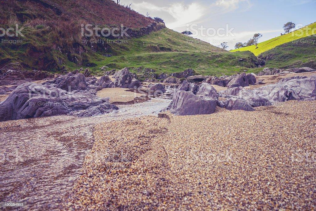 Rocks and stream on beach royalty-free stock photo