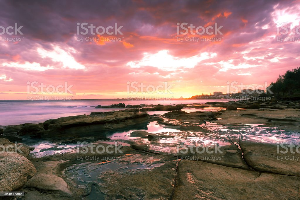 Rocks and waves at Kings Beach, QLD. stock photo