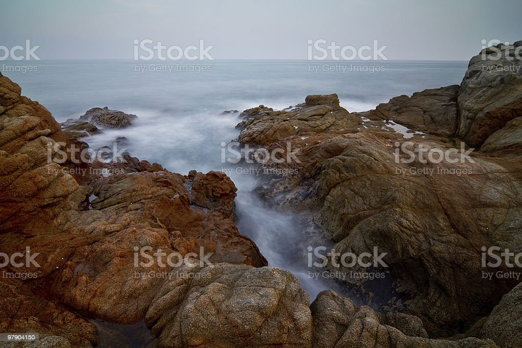 Rocks and waves royalty-free stock photo