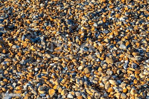 istock Rocks Background in beach 1323859380