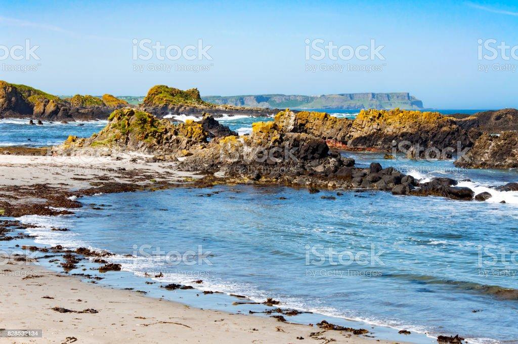 Rocks, beach and cliffs. Ballintoy, Northern Ireland, UK stock photo