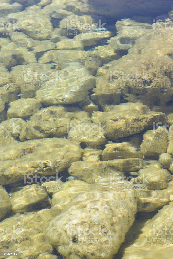 Rocks below the surface of a lake royalty-free stock photo