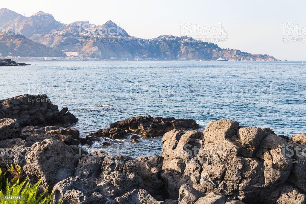 rocks coastline of Ionian sea in Giardini Naxos stock photo