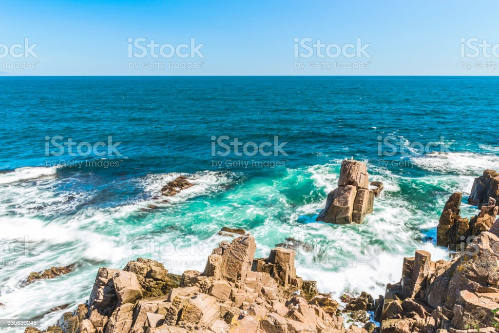 Rocks formation in the blue sea looks like a face in Sozopol, Bulgaria. stock photo
