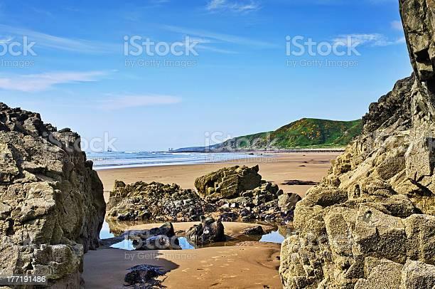 Photo of Rocks framing a view of Killantringan Bay