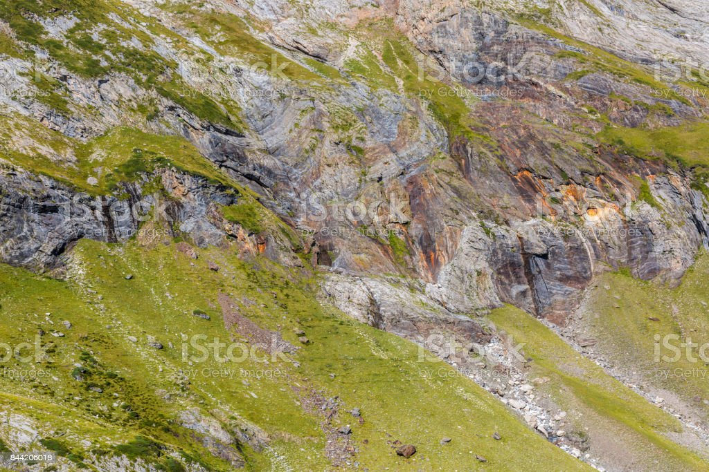 Rocks from the Glacial Circus of Troumouse in Pyrenees stock photo