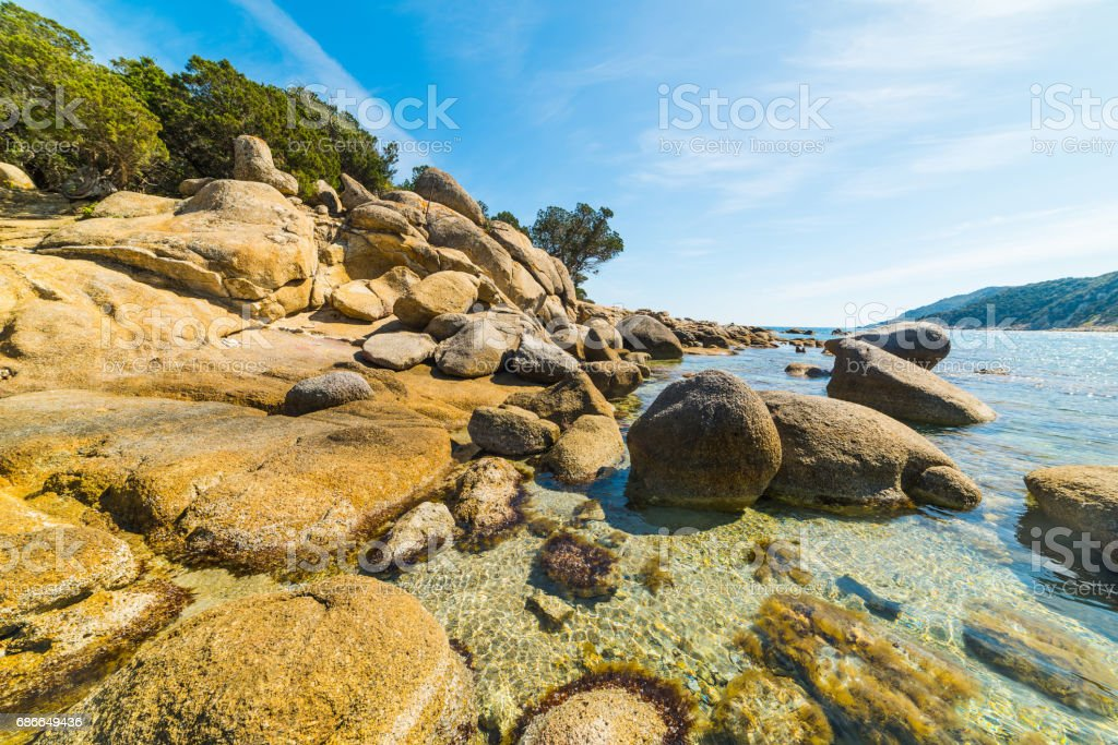 Rocks in Cala Pira shore 免版稅 stock photo