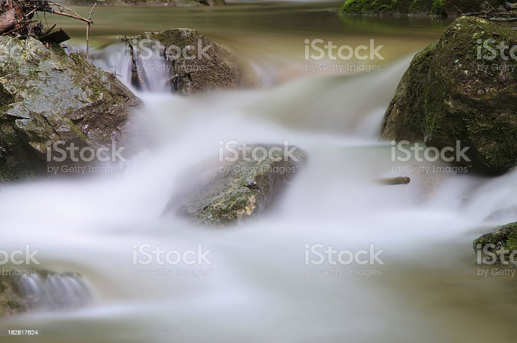 Rocks in floating water royalty-free stock photo