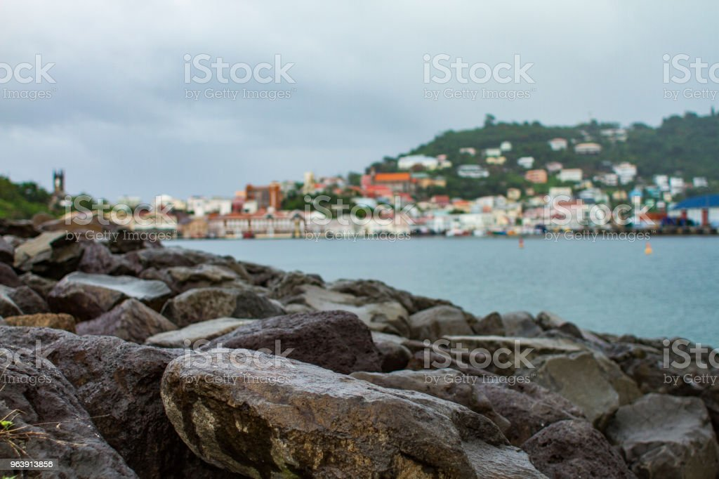 Rocks in front of Caribbean City stock photo