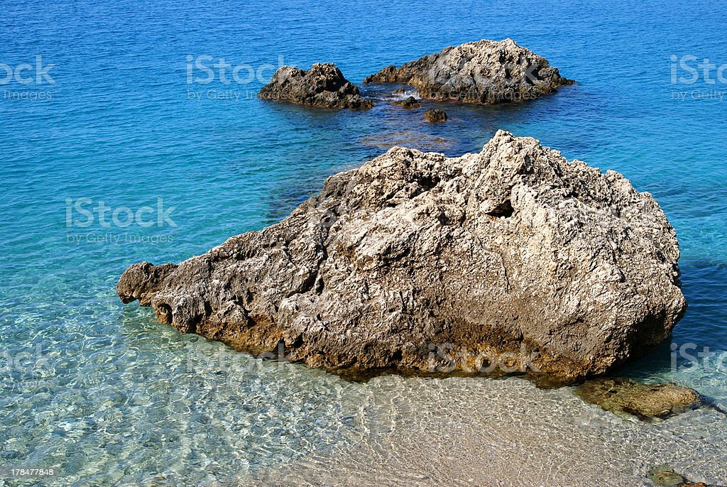 Rocks in the blue sea royalty-free stock photo