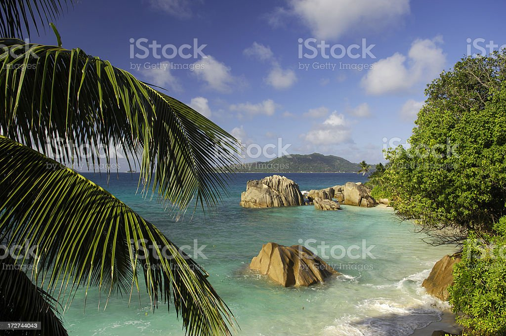 Rocks in the ocean at Anse Patates royalty-free stock photo