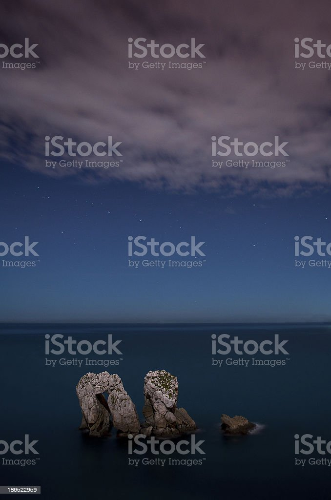 Rocks in the sea, at night, with starry sky royalty-free stock photo