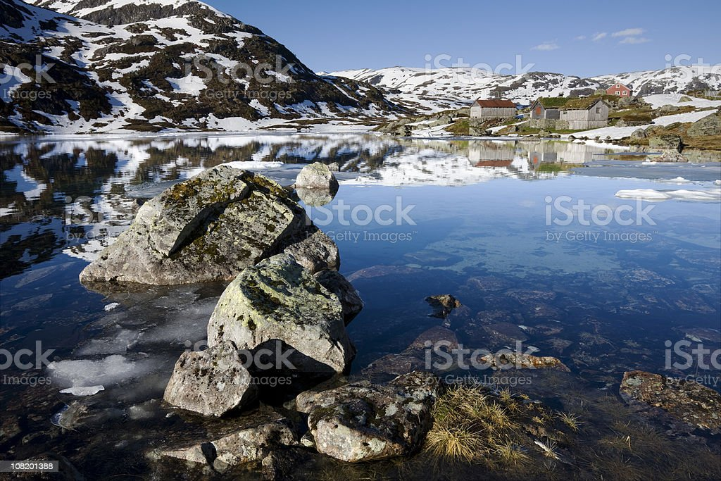 Rocks, Lake and Winter Farm royalty-free stock photo