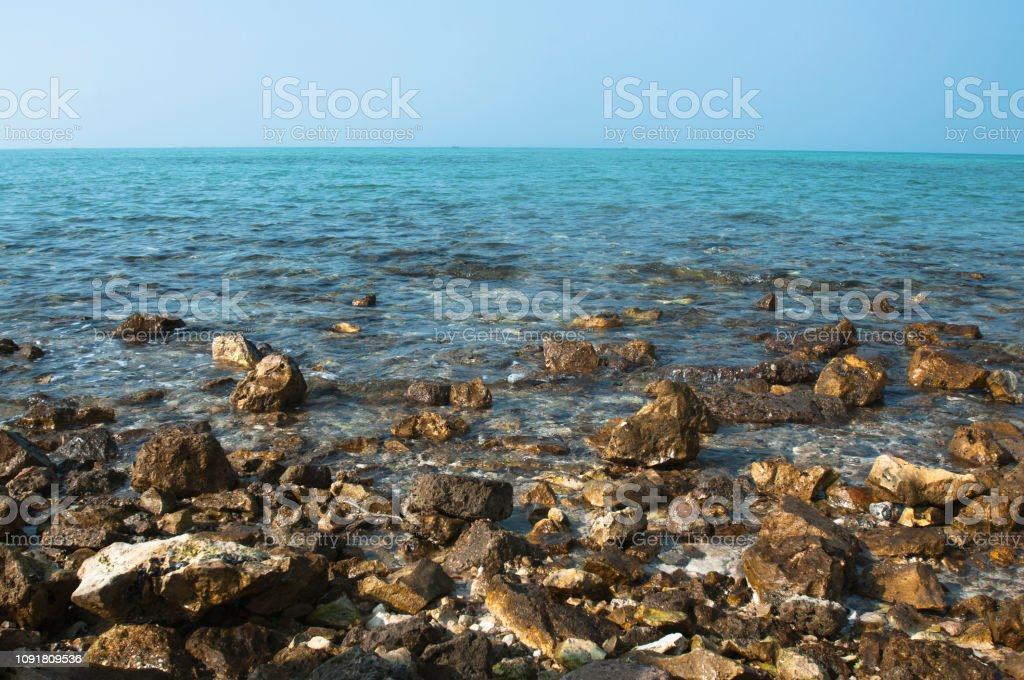 rocks of the beach at sunny day stock photo