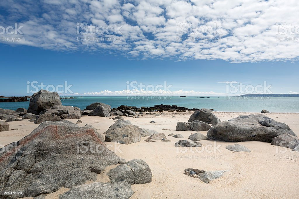 Rocks on a beach on the island of Herm, UK stock photo