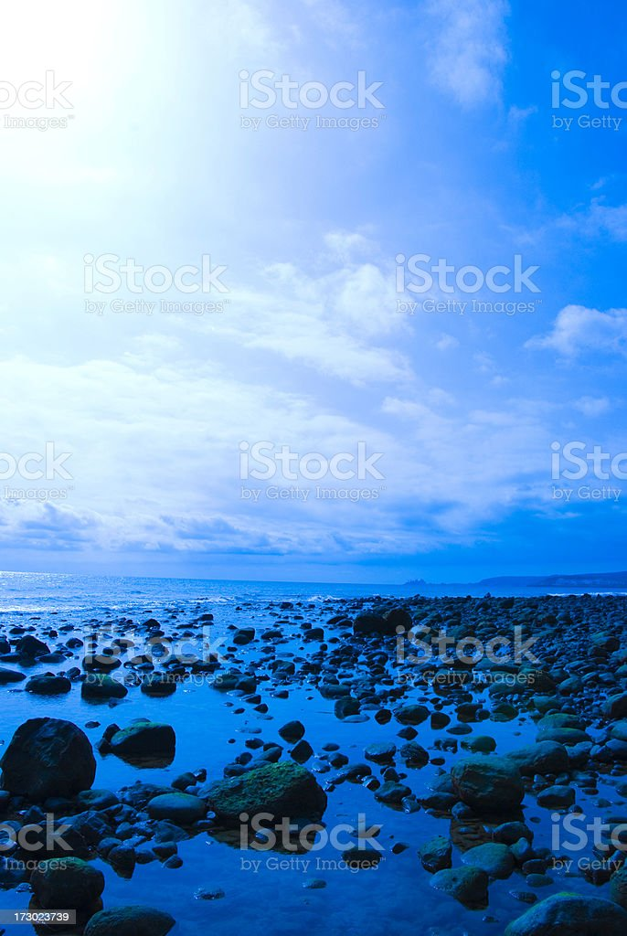 Rocks on a wet beach royalty-free stock photo