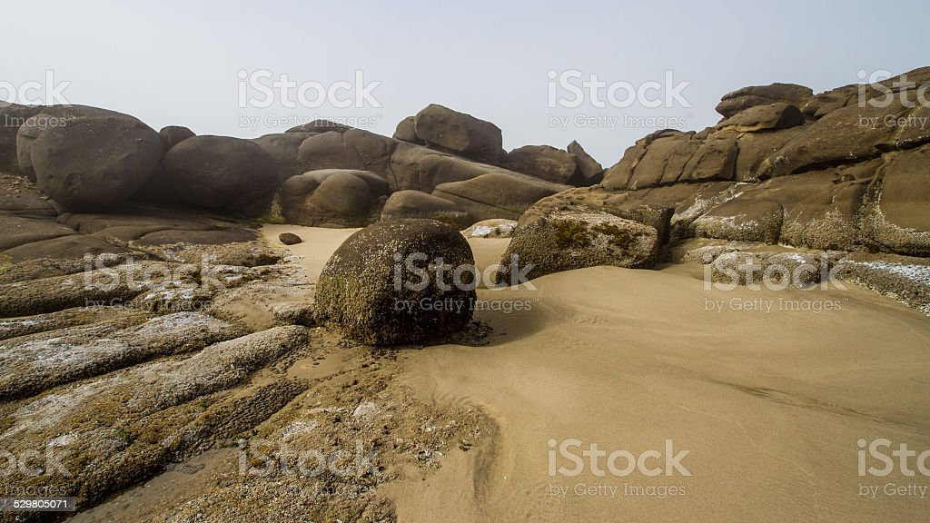 Rocks on a Windswept Beach stock photo