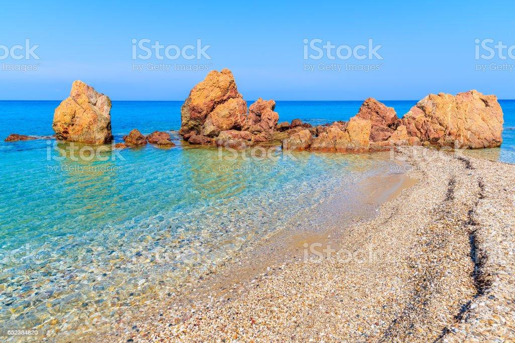 Rocks on idyllic Potami beach with turquoise crystal clear water, Samos island, Greece stock photo