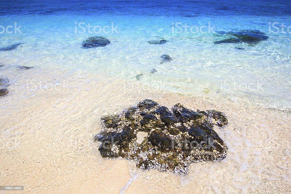 Rocks on the beach at Bamboo Island Asia Thailand royalty-free stock photo