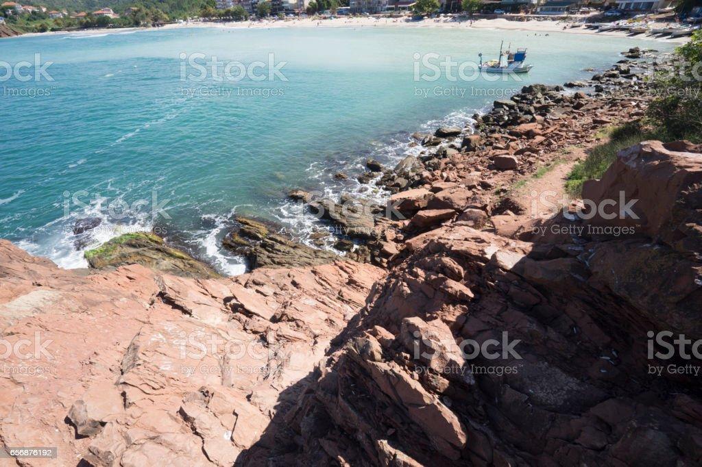 Rocks, the fishing boat and sea stok fotoğrafı