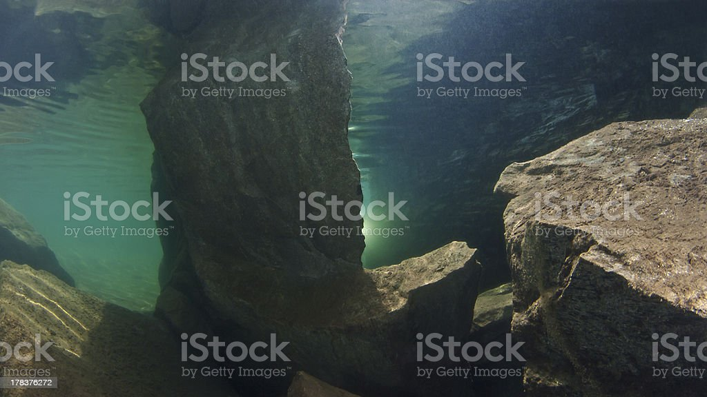Rocks under the water surface stock photo