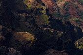 Rocks with dramatic lighting at Waimea Canyon State Park in Kauai, Hawaii