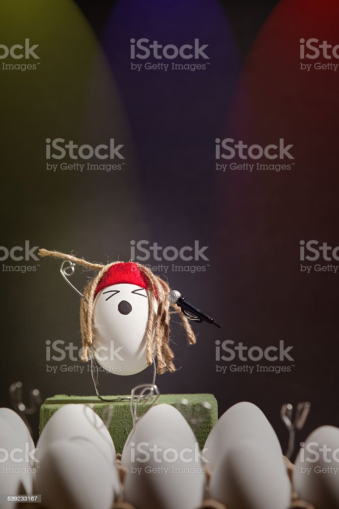Rockstar Egg Singing At Rock Concert royalty-free stock photo
