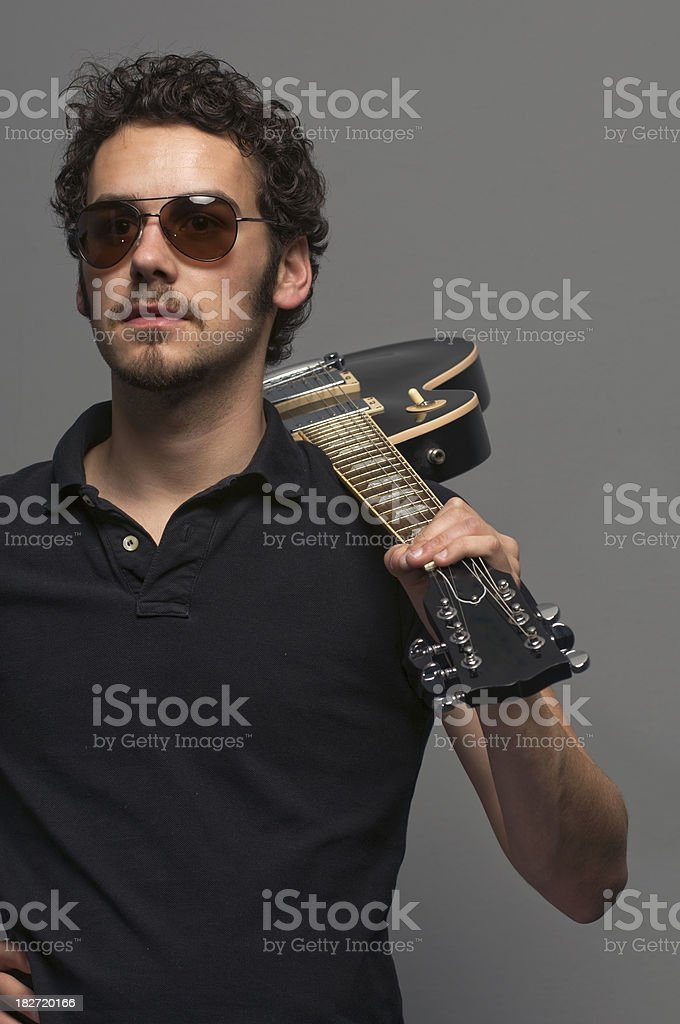 Rockstar holding a guitar royalty-free stock photo