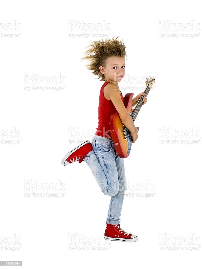 Rockstar kid  dances with electric guitar stock photo