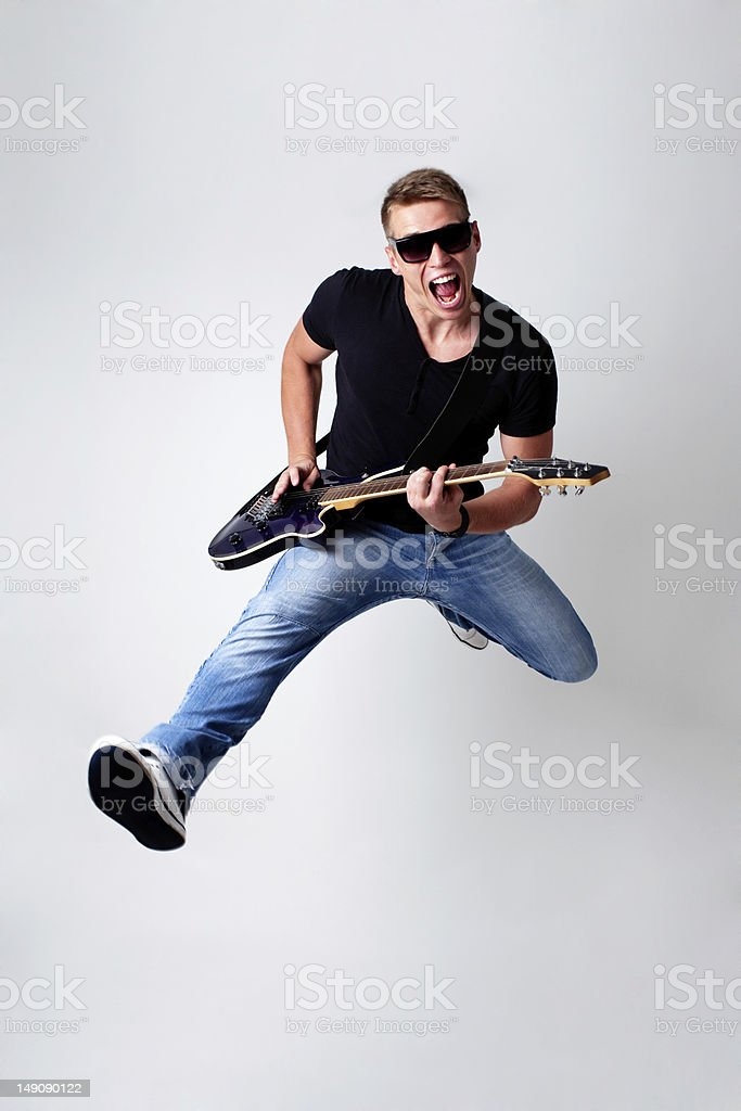 Rockstar leap with guitar stock photo