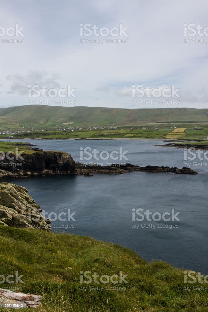A rocky arm in Blue Sea stock photo