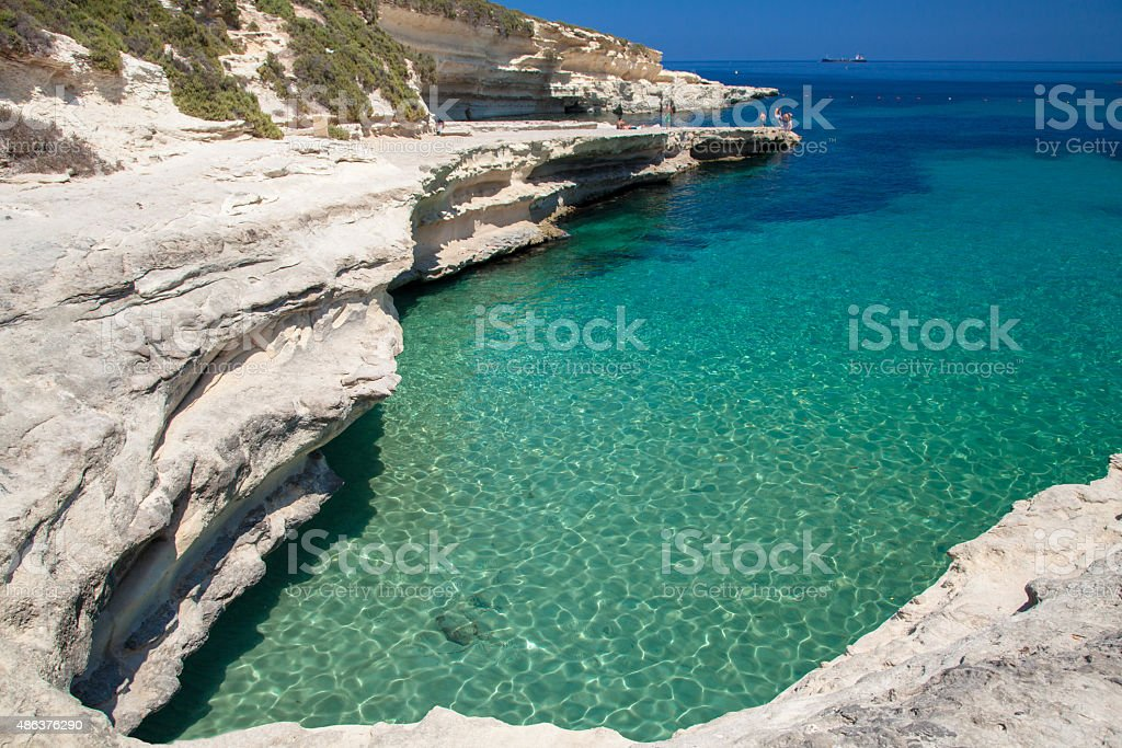 Rocky beach and blue sea stock photo