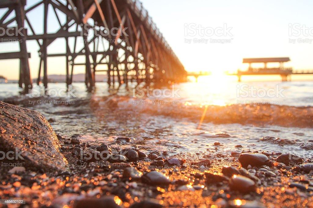 Rocky Beach and ocean wave at Sunset stock photo