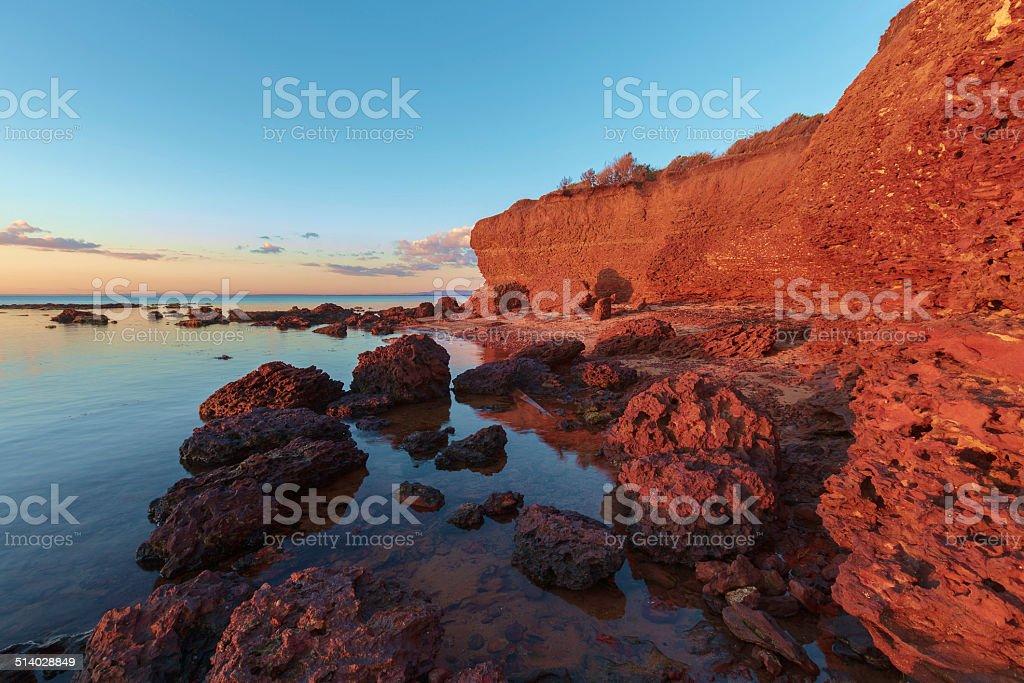 Rocky beach at sunset stock photo